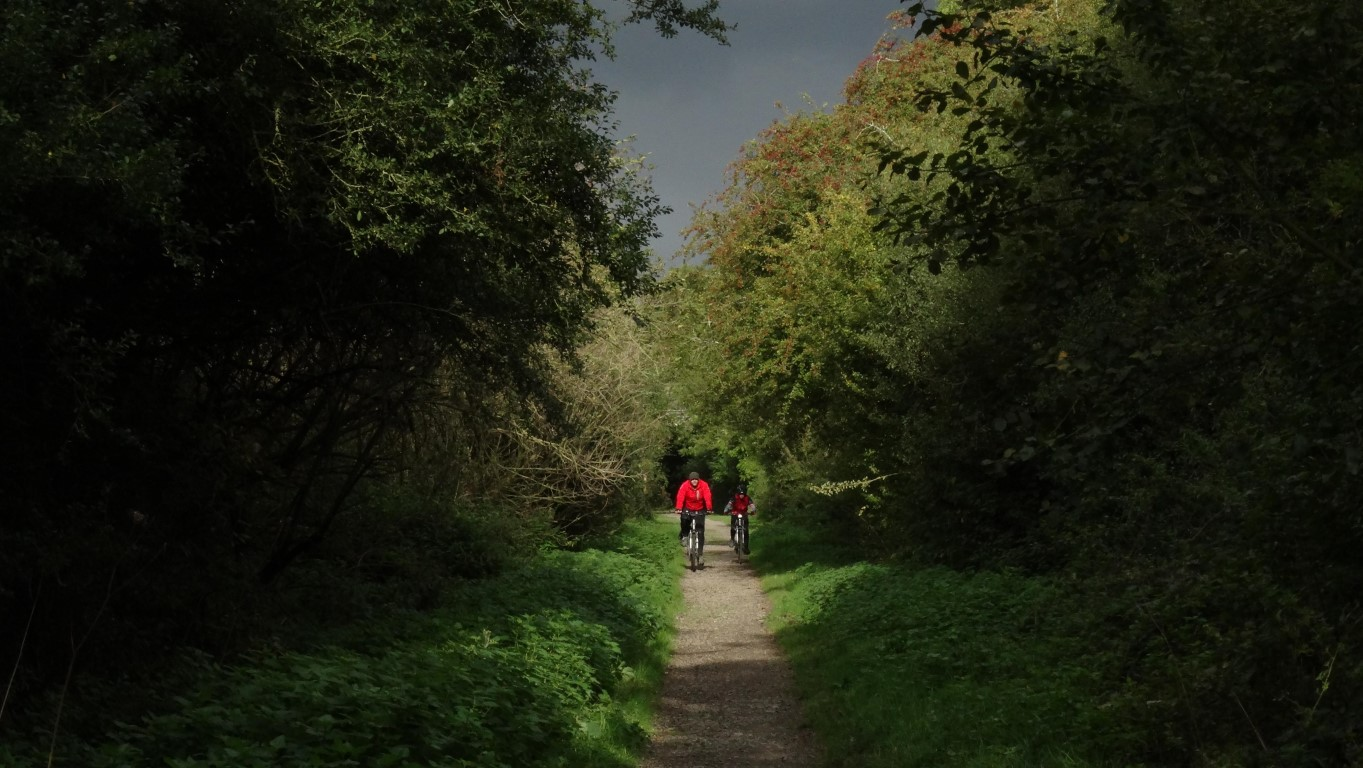 Colourful cyclists on the railway path south of Market Harborough just before it rained.