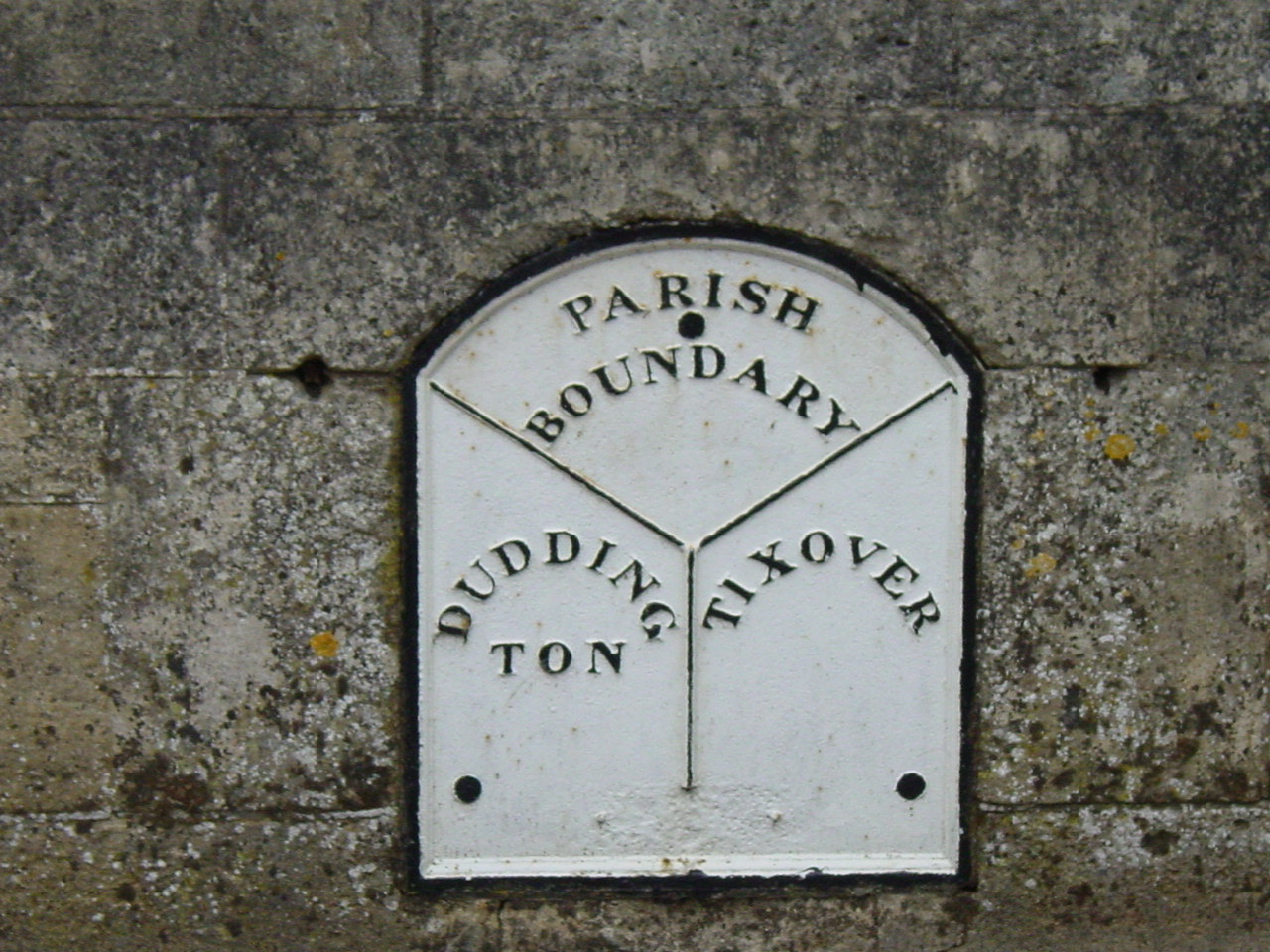 A old parish boundary sign on the border of Duddington, Northamptonshire and Tixover in Rutland (picture from 2005).