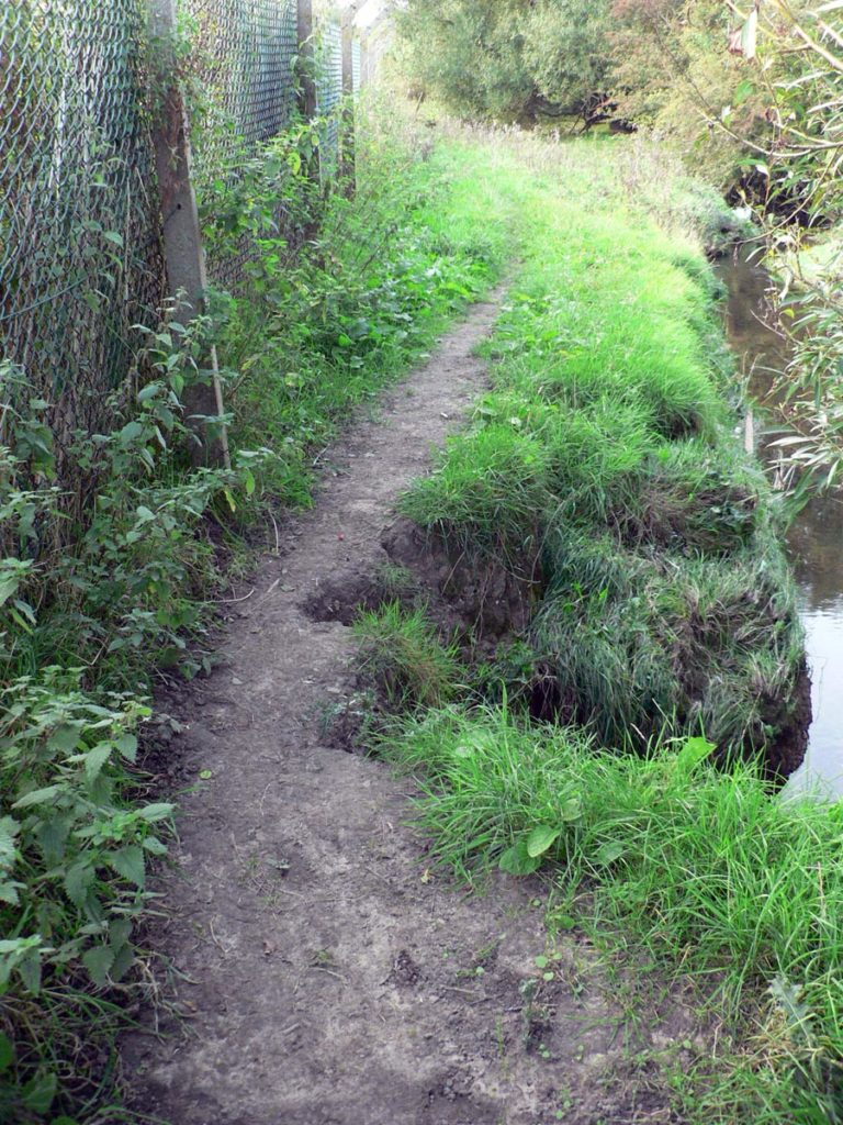 The path has been eroded by the stream over a number of years. A temporary diversion of the footpath has been implemented.